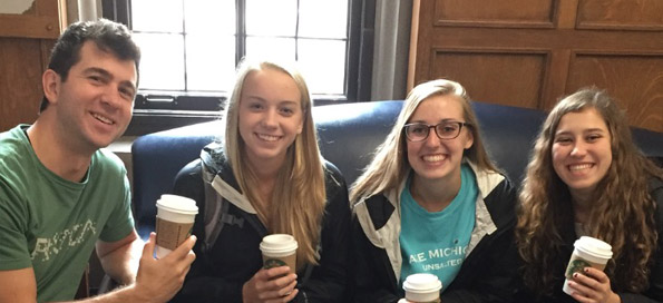 Enjoying a coffee break with some college students!