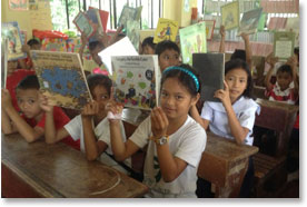 Children receive donated books in the Philippines