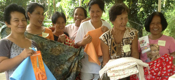 Women receive sewing supplies