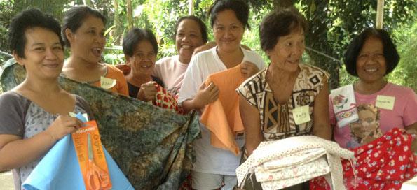Women receive sewing supplies