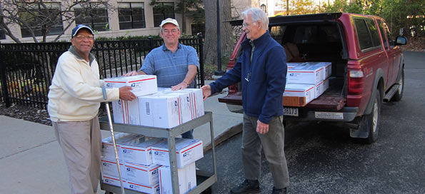 Veterans groups loading boxes for Afghanistan